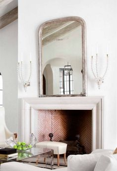 Wide low profile limestone fireplace frame/mantle