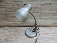 Check out this item in my Etsy shop https://www.etsy.com/listing/252717850/vintage-industrial-metal-desk-lamp