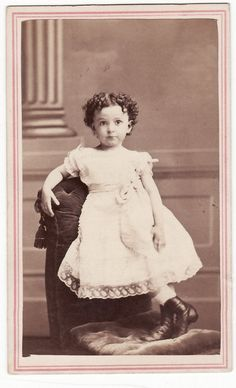 +~+~ Antique Photograph ~+~+   Impish girl with curls.