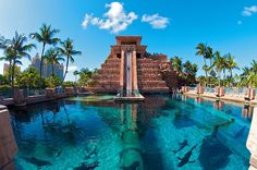Leap of Faith, Bahamas - The Leap of Faith slide has a 60-foot drop from the top of the iconic Mayan Temple, propelling riders through a clear tunnel submerged in a shark-filled lagoon