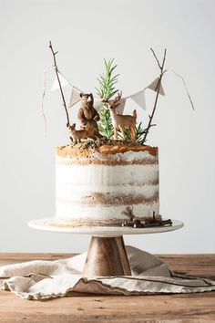 """10 Tricks to a Naked Cake - She Holds Dearly - - If you are totally intimidated by cake decorating, this simple naked cake is beautiful and forgiving. Try these decorating tips for making a """"naked cake. Boys First Birthday Cake, Boy Birthday Themes, 1st Birthday Decorations Boy, 1st Birthday Ideas For Boys, Camping Birthday Cake, Hunting Birthday Cakes, Twin Birthday Cakes, Camping Cakes, 1 Year Birthday"""
