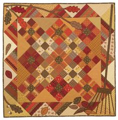 Shades of Autumn: Autumn appliques are a perfect match for an easy-to-piece quilt.