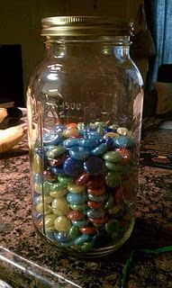 "Blogger says: ""I've been thinking about ways I could make my weight loss tangible so that I can not only see my progress but have a reminder out and about in my apartment to always be mindful...I want to lose 40 pounds so I filled the jar with 400 rocks. Each rock represents .1 lb so every Thursday when I weigh myself, I will take out the appropriate number of rocks from the jar until the jar is empty!""    What a GREAT idea/motivational tool!!"