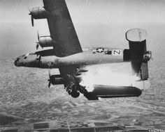 B-24L 'Stevonovitch II' of the of the 464th Bomber Group hit by German anti-aircraft fire over Lugo, Italy, 10 Apr 1945; only 1 out of the crew of 10 survived