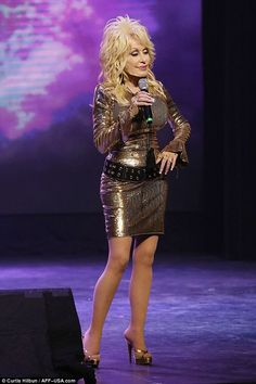 Glittered: Her outfits included a gold metallic mini dress with long sleeves and wide black studded belt and matching gold heels with platform soles Older Women Fashion, Sexy Older Women, Dolly Shop, Dolly Parton Costume, Dolly Parton Pictures, Metallic Mini Dresses, Hello Dolly, Beautiful Celebrities, Celebs