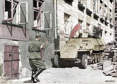 Resistance fighters of the Polish Home Army wave the flag of Poland from a captured German SdKfz. of August Pin by Paolo Marzioli Poland Ww2, Poland Flag, Warsaw Poland, Story Of The World, Second World, Warsaw Uprising, Operation Barbarossa, Warsaw Ghetto, Home Guard