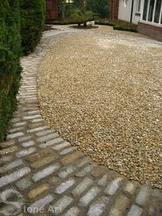 Love the way this stone path frames and gives shape to the landscape. Design by Sunny Wieler.