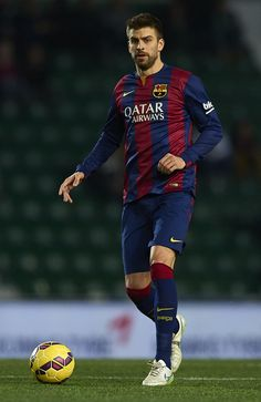 Gerard Pique of Barcelona in action during the La Liga match between Elche FC and FC Barcelona at Estadio Manuel Martinez Valero on January 24, 2015 in Elche, Spain.