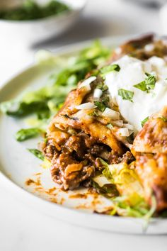 Easy Beef Enchiladas made with a tasty and saucy ground beef filling and smothered in the best homemade enchilada sauce. Great for weeknight dinners and leftovers! Authentic Enchilada Sauce, Recipes With Enchilada Sauce, Homemade Enchilada Sauce, Mexican Food Recipes, Beef Recipes, Dinner Recipes, Ethnic Recipes, Dinner Ideas, Health Recipes