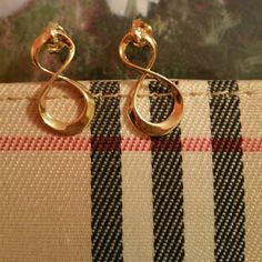 18k gold plated infinity earrings A classic,  amazing quality, trendy,  Gold imported from Venezuela,  made in USA,  not chinese quality. Jewelry Earrings