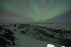 A special New Years surprise! Northern Lights tonight over Gullfoss waterfall in Iceland! [60004000] [OC] #reddit