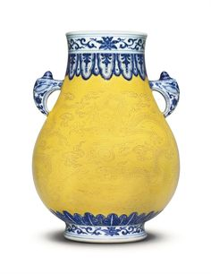 A fine and rare Qing Dynasty underglaze-blue-decorated, body incised under an egg yolk-yellow glazepear-shaped vase. Qianlong seal mark in underglaze blue and of the period (1736-1795)  @ Christies