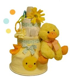 Quack! Quack! This lovable Ducky Diaper Cake celebrates the arrival of your sweet little bundle!  The new parents will be delighted to receive this beautiful diaper cake featuring brand name disposable diapers, a cute ducky plush toy, blankets, and more! The entire diaper cake is carefully made so each diaper is fully functional, usable and clean. Arrives wrapped in crisp, clear cellophane and topped with a bow, this is sure to impress the most discriminating parent!Availability:Usually ...