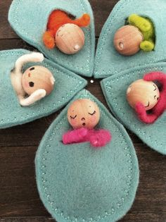 Adorable! Tiny baby dolls in leaf beds.: