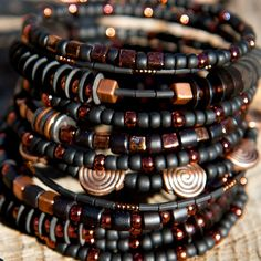 Black seed beads and copper memory wire bracelet by ULALO on Etsy, $50.00 #seedbeads