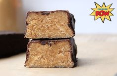 THE ULTIMATE PEANUT BUTTER PROTEIN BARS - 1/3 cup defatted peanut flour - 1/3 cup vanilla whey protein powder - 1/4 cup of cartoned coconut or almond milk - 1/3 cup of ground almonds - 2 tbsp coconut flour - 4 squares of dark chocolate (I used 85% Lindt)