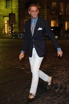 Lapo Elkann ~   The street style regular styling things up as only he can do. The takeaway here? Your white jeans aren't just for the warmer months.