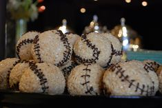 Giants' catering company made these for a suite tasting event.     The pastry chef said he forms the balls while the treats are still warm. He then sets each one on a cup and uses an icing bag to pipe the chocolate. You have to wait for the chocolate to harden before you can move the ball.