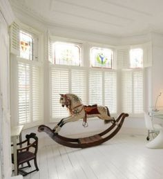 Plantation shutters in the nursery/ kid´s room.  Plantation shutters beautiful and completely safe for children - no strings attached!