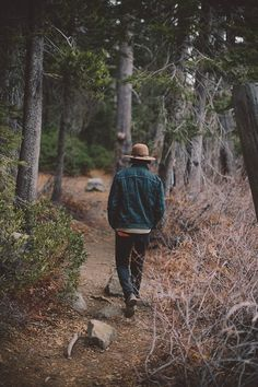 Rugged hiking inspiration with a brown fedora dark wash denim jacket boots dark denim jeans gray beige sweater