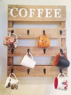 22 Easy DIY Reclaimed Wood Projects for Your Home, DIY and Crafts, Craft this cute coffee mug organizer that will add an artistic piece to your kitchen wall. Use paint and a sponge for the stenciled top. Pallet Crafts, Diy Pallet Projects, Pallet Ideas, Wood Ideas, Simple Wood Projects, Wood Projects That Sell, Pallet Designs, Diy Wood Crafts, Diy Home Projects Easy