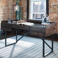 The Starmore Writing Desk from Ashley Furniture is a dream piece for anyone with a taste for rustic industrial style. Made with wood in an oiled walnut finish and metal in a blackened gun metal gray finish. 3 drawers. Add to your living room or home office for stylish table space. Ashley Starmore Rustic Industrial Writing Desk   Weekends Only Furniture and Mattress