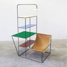 Rack + seat made of steel, colored polyethylene and leather. Decoration and design furniture in Paris.