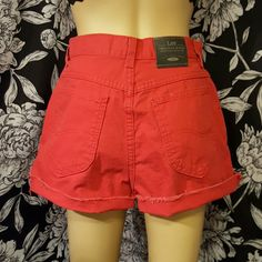 """Vintage red high waisted shorts Perfect for summer! Cut off high rise shorts  Brand- Lee Marked size- 12  Approximate measurements laying flat  13.5"""" waist  13"""" Rise 2"""" inseam Vintage Shorts Jean Shorts"""