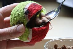 """A great activity to be adapted for Halloween thematic work- feeding """"monsters"""" made of tennis balls! Great for building gripping strength and fine motor control."""