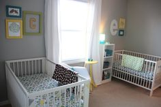 twin boy nursery...nice colors and layout.... Love the colored frame groupings above cribs
