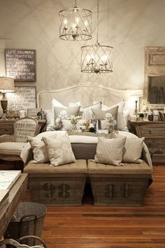 In love with so many aspects of this room....the crates at the foot of the bed, the quotes, the lighting, the bucket....****sigh