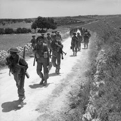 Men of the 2nd Seaforth Highlanders advance along a road near Noto,  Sicily, Italy.11 July 1943. #WWII #War