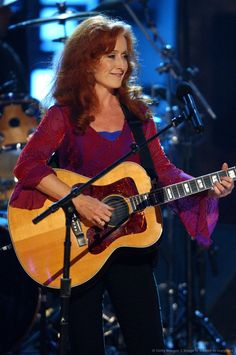 """""""This old house is falling down around my ears. I'm drowning in a river of my tears. When all my will is gone you hold me sway. I need you at the dimming of the day. Female Guitarist, Female Singers, Blues Artists, Music Artists, Soul Music, Music Is Life, Bonnie Raitt, Women Of Rock, Guitar Girl"""