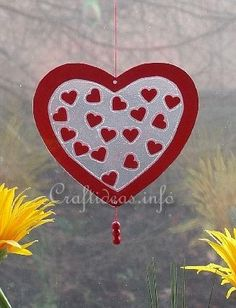 Valentine's Day Craft - Transparent Heart Window Decoration.  Full tutorial on site.  What they call self-adhesive foil is actually clear contact paper.