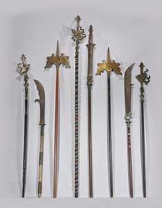 """EIGHT VINTAGE/ANTIQUE CHINESE WEAPONS Collection of eight various vintage/antique Chinese polearm weapons/standards; several with Buddhist emblems and dragon heads, with bronze and iron ornamentation; H: 98"""" (tallest); Provenance: Formerly in a collection of Armand J. Labbe, curator with the Bowers Museum; by repute collected after the Boxer Rebellion Circa 1900; 3d Fantasy, Fantasy Weapons, Chinese Weapons, Medieval, Cosplay Sword, Armas Ninja, Martial Arts Weapons, Military Weapons, China"""