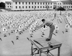 U.S. boxer Gene Tunney leading the Navy's physical fitness program, 1941.