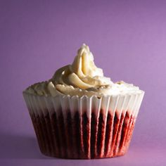 Red velvet cupcakes with rum syrup and cream cheese frosting