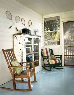A sun porch provides a spot for relaxation at Camp Wandawega near Elkhorn--this article gives pricing for weddings.