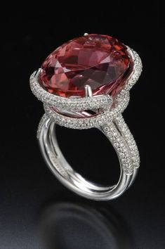"TAMIR ""Sweet"" pinkish Orange Tourmaline and Diamond Ring."