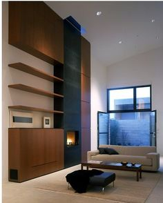 Build out cabinet storage around our fireplace instead of our current bare wall; not modern style like this, but similar concept.