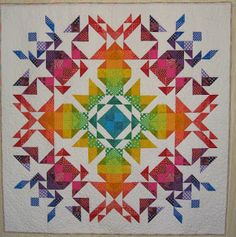 I found a photo of this quilt on Pinterest and loved it because of the rainbow colors and I love a double mirror image symmetry style quil...