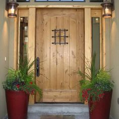 Cool-Big-Succulent-Planter-With-Red-Paint-Idea-Feat-Rustic-Exterior-Front-Door-Design-Plus-Big-Wall-Sconces.jpg (960×960)