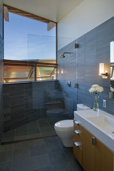 Like combo of rectangle and square gey tile, open shower.