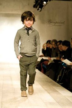 That is the sly smile of someone who will one day run the world. But for now he must run this catwalk.