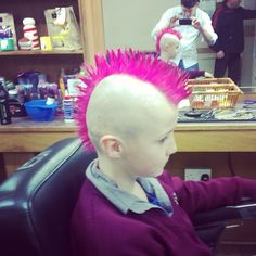 boy with pink mohawk....not too crazy about the color, but if you are going to wear a mohawk i don't think it matters