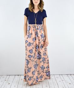 A whimsy floral print brings feminine charm to this floor-sweeping maxi dress. 59'' long from high point of shoulder to hem95% polyester / 5% spandexHand washMade in the USA