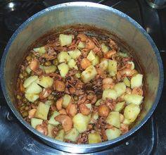 Le mani in pasta: Seppie con patate e piselli