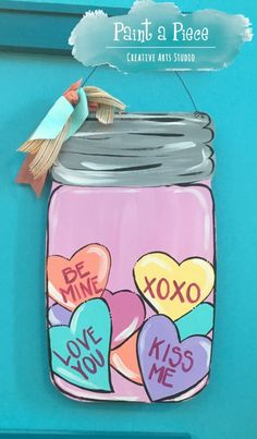 Valentine's Day Candy Heart Mason Jar Wooden Door Hanger created at Paint a Piece in Germantown, TN.