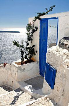 Blue door opening to endless blue.. Oia, Santorini, Greece