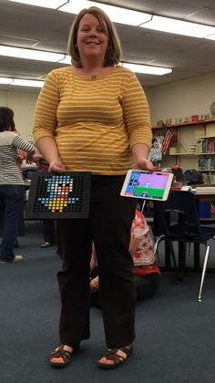 A training participant shows off the videogame she built using Bloxels Videogames, Training, Building, Coaching, Buildings, Fitness Workouts, Video Games, Work Outs, Education